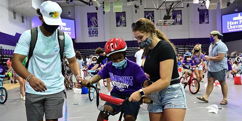 HPU's New Students Present Bikes to Local Children